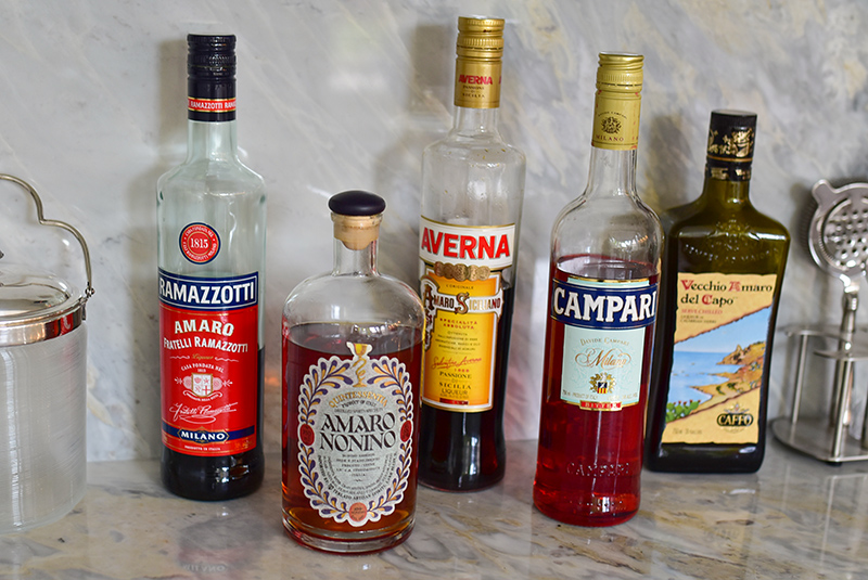 Bottles of Amaro on the bar