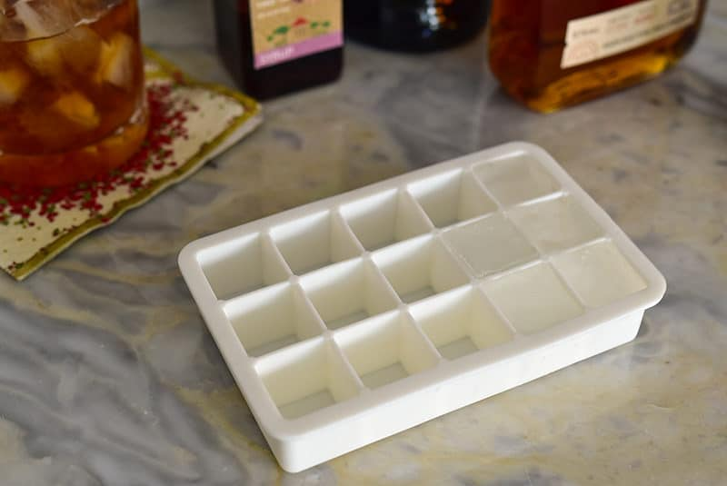 Square ice cube tray on a marble bar