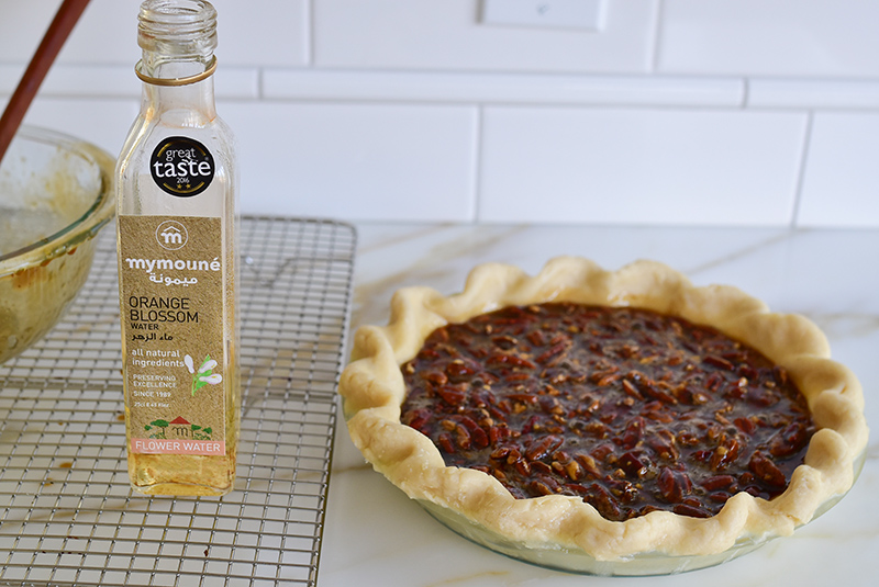 Pecan pie with a bottle of Mymoune Orange Blossom Water
