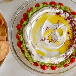 7 layer dip Mediterranean style in a pie plate