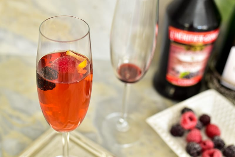 Kir Royale with frozen berries