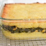 Potatoes layered with spinach in a glass dish