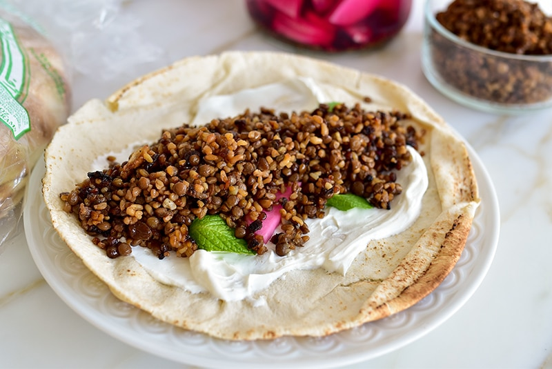Labneh, pink turnips, mint and mujadara on a pita