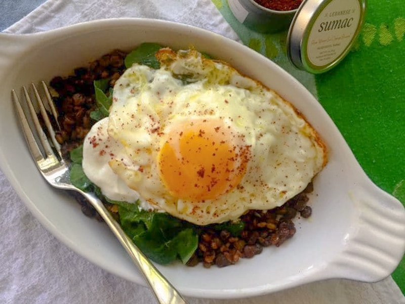 Fried egg in a dish with mujadara
