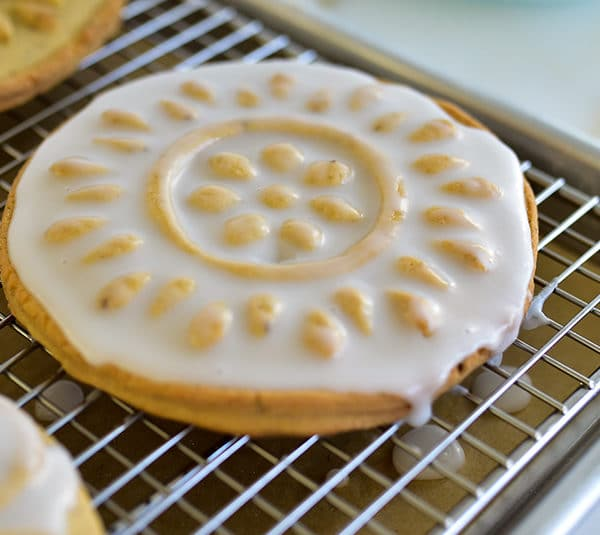 White iced shortbread cookie on a cookie rack
