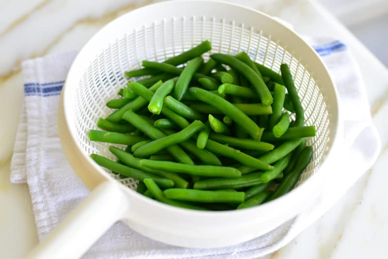 Green beans in a white colander