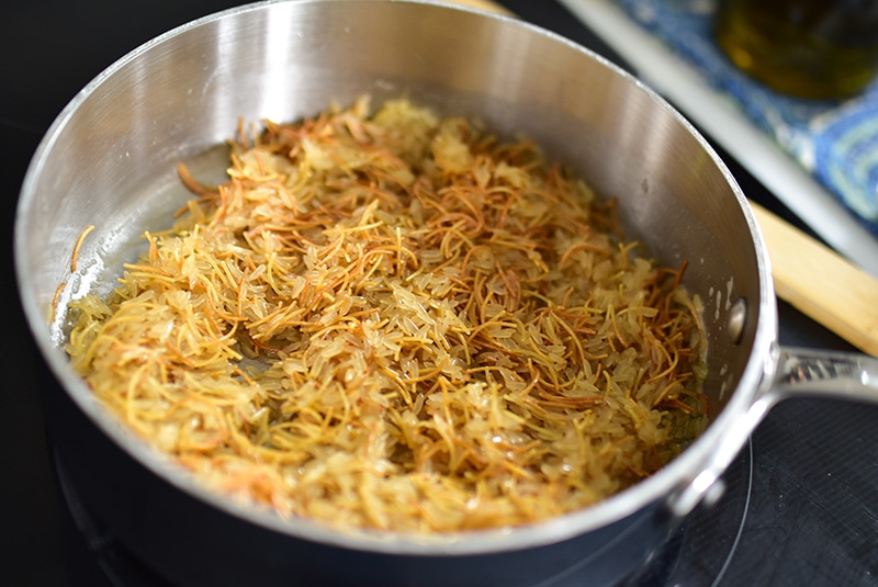 Browned butter with vermicelli pasta pieces in a pan
