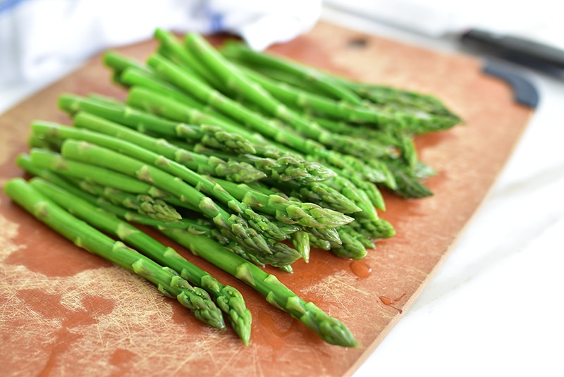 Blanched asparagus on a board