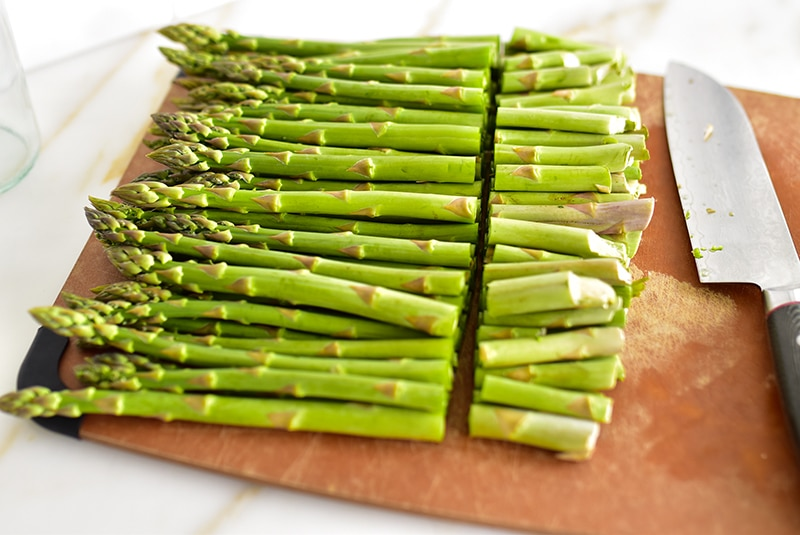 Row of asparagus with cut stems