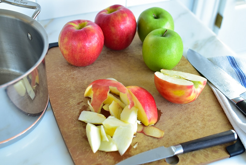 Sliced apples with knife on a cutting board