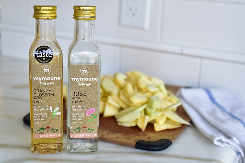 Flower waters with sliced apples