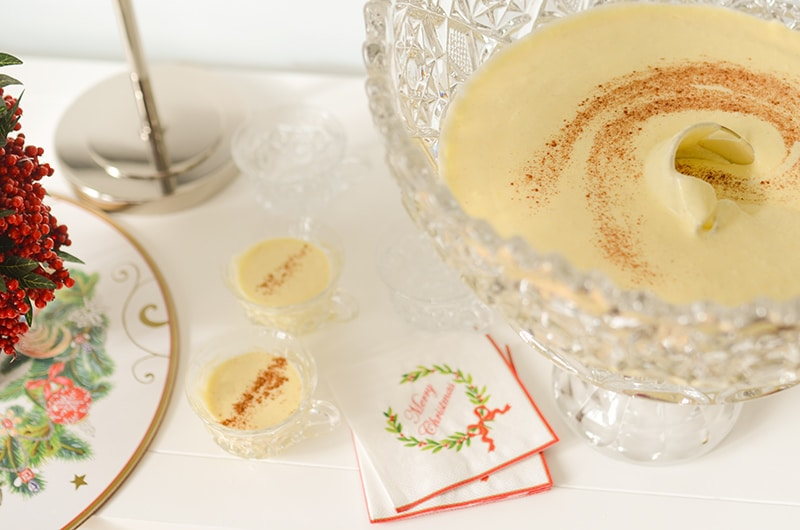 Eggnog in crystal cups with cinnamon and Christmas napkins