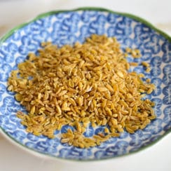 Dry freekeh in a blue dish